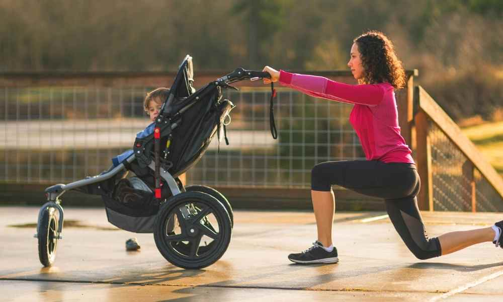 Mom doing lunges with jogging stroller